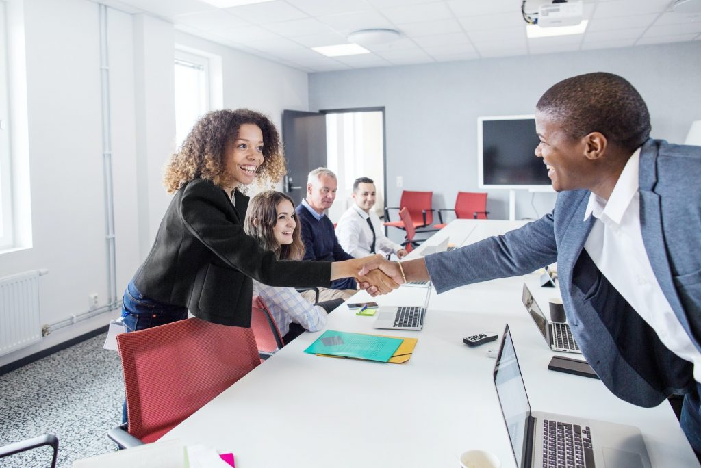 Architect greeting colleague at office meeting
